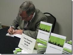 John signing autographs2